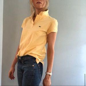 Lacoste. Mustard yellow polo classic